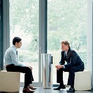 Businessmen Smoking Cigarettes by Door