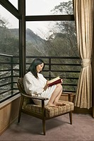 Woman Reading Book in Robe