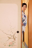 Woman in Kimono Opening Door Screen