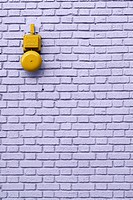 Alarm on brick wall