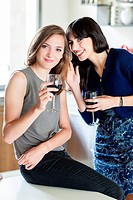 Women drinking a glass of red wine.