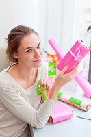 Woman preparing gifts.