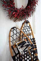 Snowshoes leaning on door