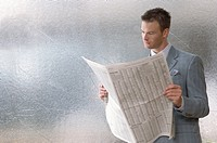 Businessman reading the stock pages
