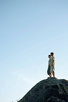 Couple standing on a rocky hill