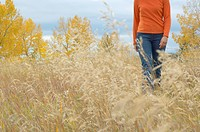 Woman walking through a field