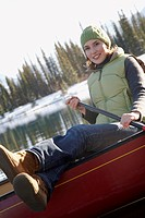 Happy woman in a canoe
