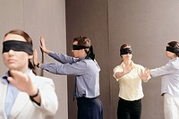 Businesspeople Wearing Blindfolds