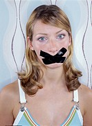 Young woman with tape covering her mouth