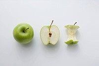 A whole apple, half an apple and an apple core