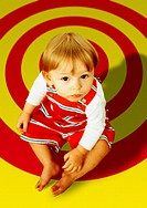 Child Sitting on Red and Yellow Target Floor