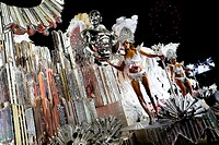 Dancers of Renascer de Jacarepagua samba school perform atop a float during the Carnival parade at the Sambadrome in Rio de Janeiro, Brazil, 20 Februa...