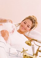 Woman Smiling in Bubble Bath