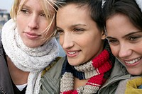 Three Young Women Wearing Scarves