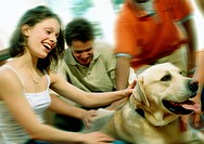 Teens Giving Retriever Attention