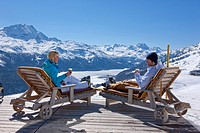 Couple, deck chair, restaurant, Trutz, view, Engadin, Engadine, winter sports, canton, GR, Graubünden, Grisons, Oberengadin, winter sports, winter, ca...