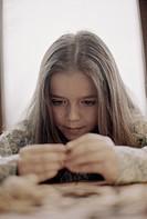Girl Examining Seashells