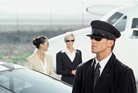 Businesswomen Walking Towards Chauffeur