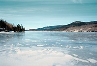 Frozen Lake with Hills in Background