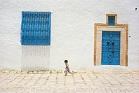 Tunisia, Sidi Bou Said  Little Boy Walking in the Street