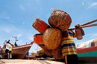 A fisherman carry fishing baskets at Worli Village in Bombay now Mumbai ; Maharashtra ; India