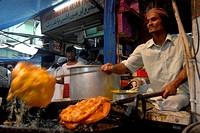 A food vendor prepare eatables as Muslims break their Ramzan or Ramadan fasting at Khatri Masjid in Pydhonie ; Bombay now Mumbai ; Maharashtra ; India