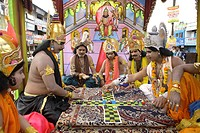 Janmashtami festival or Lord Krishna birthday celebration carnival procession with various scene from epic Mahabharat depicting game like chess played...