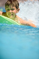Boy on float in swiming pool