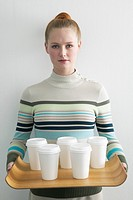 Young Woman Holding Tray with Cups