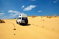 View of a jeep driving through The Pinnacles, Nambung National Park, Australia