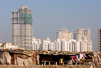 Towers at Hiranandani complex with worker´s cottages in Powai , Bombay Mumbai , Maharashtra , India