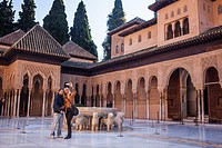 Tourists in Courtyard of the lions  Palace of the Lions  Nazaries palaces Alhambra, Granada  Andalusia, Spain
