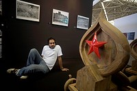 Riyaz Komu Indian contemporary artist painter posing near his wood sculpture , Amsterdam Art Fair , Amsterdam , Netherlands , Europe NO MR