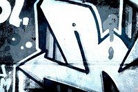 Graffiti over old dirty wall, urban hip hop background Gray text