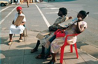 Beauticians advertising cosmetic treatments on street in Durban, South Africa