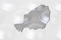 Outline map of niger with pills in the background for health and