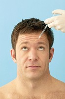 Man Receiving Botox Injection in Forehead