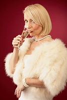 Wealthy Mature Woman Drinking Champagne
