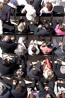 Businesspeople Taking Their Seats at Outdoor Seminar