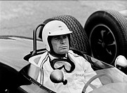 Garner, James, * 7.4.1928, American actor, half length, sitting in racing car, during making of Grand Prix, 1960s, helmet, protection glasses,