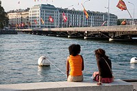 Two Young Women Relaxing by Lake Geneva, Geneva, Switzerland, Europe,