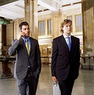 Two Businessmen Waiting in Lobby