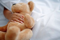 Little Girl with Teddy Bear in Bed