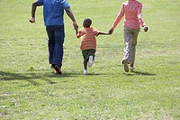 Carefree family running in park
