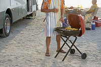 Man grilling corn