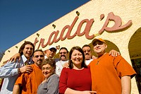 Extended Family Smiling in Front of Their Restaurant