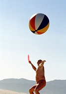Man Serving with a Beach Ball