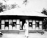 Mahatma Gandhi´s temporary secretary Nirmal Kumar Bose leaving the hut in which Mahatma Gandhi stayed alone for a month in Srirampur Noakhali East Ben...