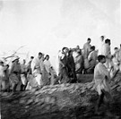 Mahatma Gandhi , Sushila Nayar and others on march through the riot stricken area of Noakhali East Bengal , November 1946 , India NO MR