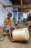 Making of copper utensils in vessel manufacturing industry in Anupparpalayam metal town ; Tirupur ; Tamil Nadu ; India